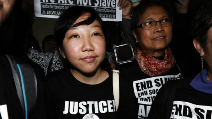 Hong Kong woman ordered to pay abused Indonesian maid $100,000