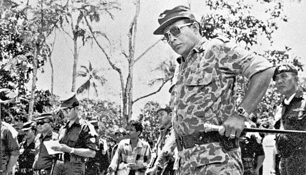 """Lesson learned – Then Maj.Gen.Soeharto (right) let an operation to remove the bodies of military generals, who were killed and dumped into a well at the G30S coup headquarters called """"Lubang Buaya"""" in the 1965 incident."""