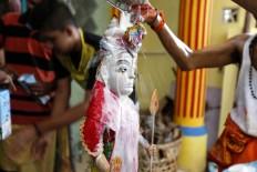 A statue is bathed in milk as the priests complete the Panguni Uthiram ritual. JP/ Hotli Simanjuntak