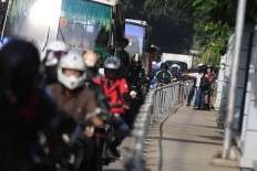 Alfini began to block a group of motorcycle attempting to avoid traffic by trespassing on a sidewalk on Monday. She took action to protest unruly bikers. The Jakarta Post/ Dhoni Setiawan