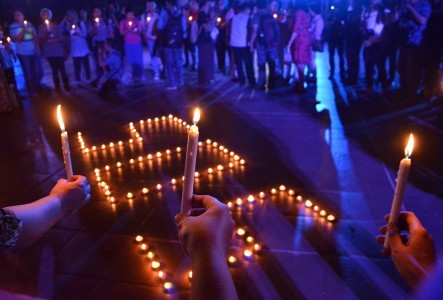 People join and light candles during Solidarity Night for Save Our Sisters At Proclamation Monument in Jakarta on Friday, May, 13, 2016.  The event was held to show solidarity for victims of sexual violence and commemorate the 40th day of the death of Y, the 14-year-old girl who was brutally raped and killed by 14 young men in Bengkulu.