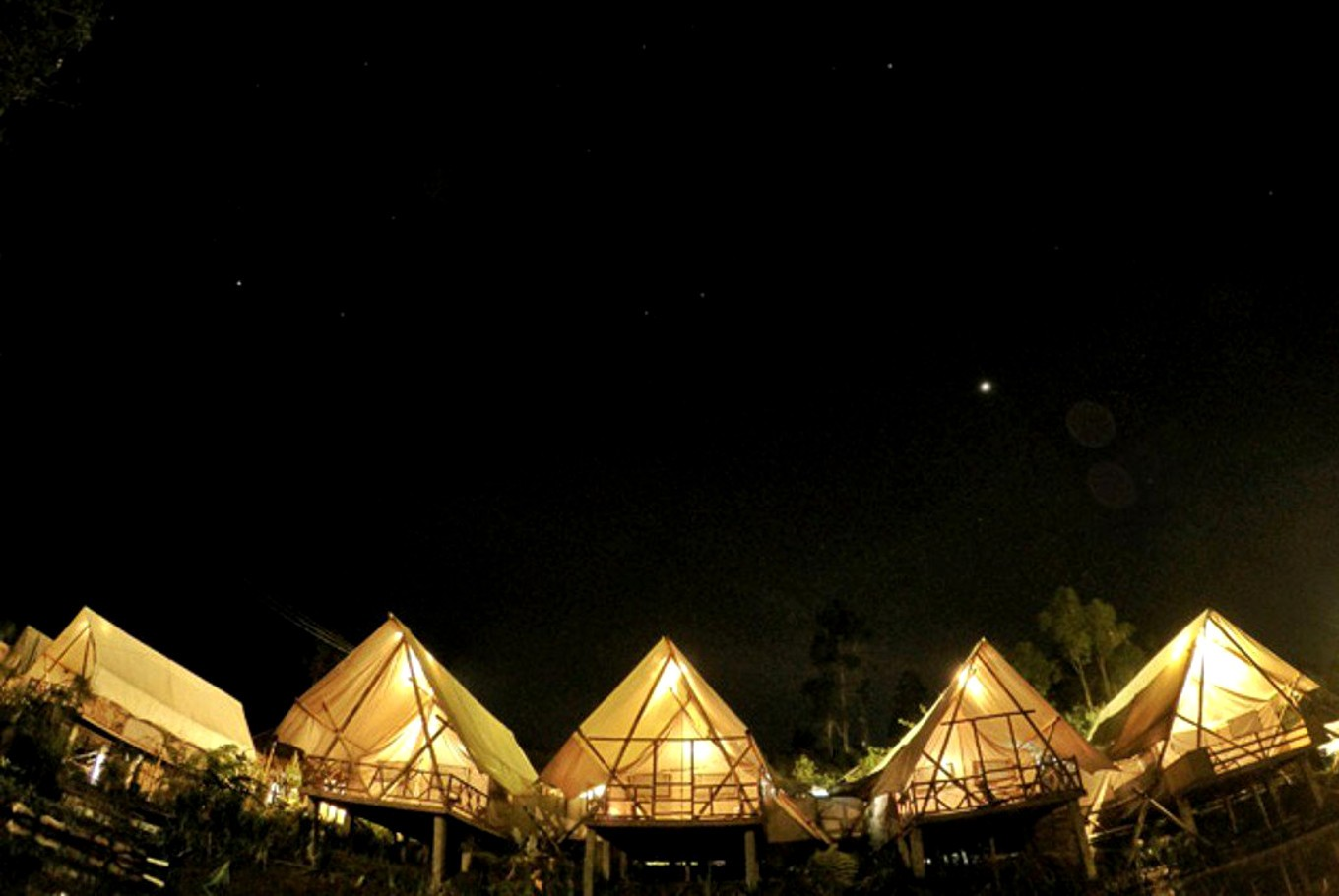 Get ready to marvel at the breathtaking view from Glamping Legok Kondang Lodge's Deluxe Tent.