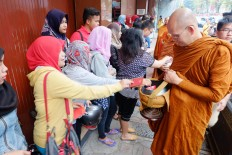 Muslim residents give alms to the priests. JP/Tarko Sudiarno