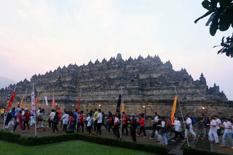 Thousands of worshipers join in the procession to circle Borobudur Temple as part of Pradaksina ritual. JP/Tarko Sudiarno