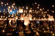 Thousands of worshipers and visitors release 5,000 lanterns symbolizing prayers. JP/Tarko Sudiarno