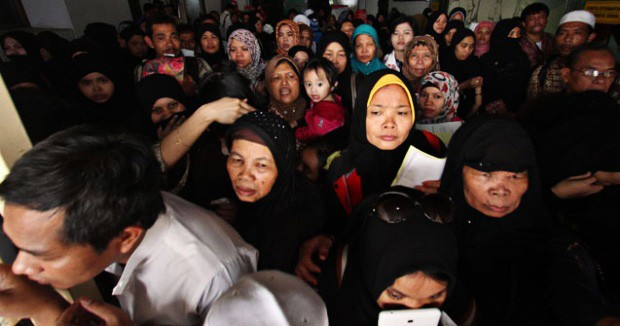 Indonesian migrant workers in Saudi Arabia queue for an immigration check on their way to return home, in this undated picture taken before the COVID-19 pandemic.