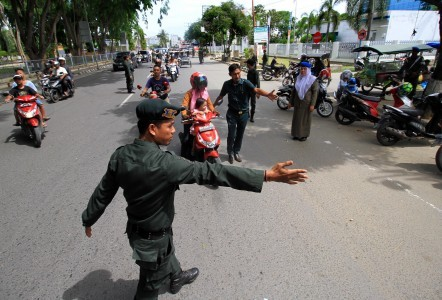 Dozens of women stopped in Aceh for straddling motorcycles