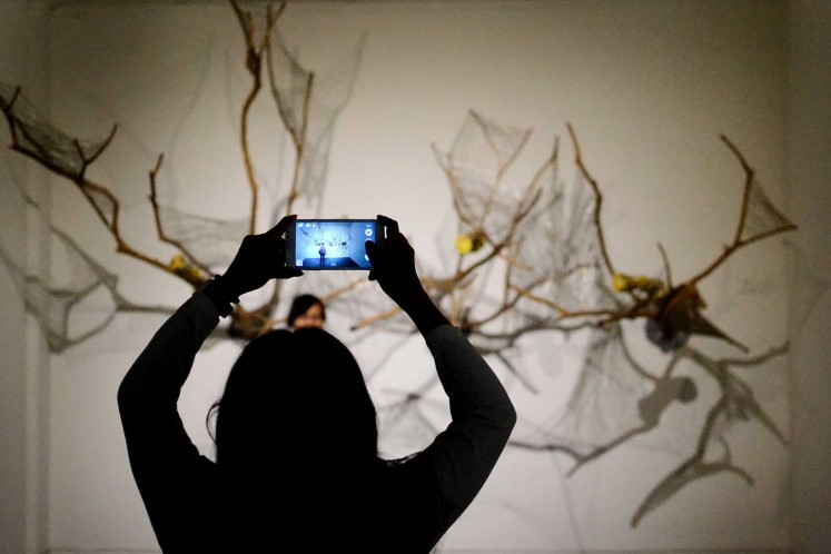A display at ARTJOG 2016 is used as a backdrop by young visitors taking pictures.