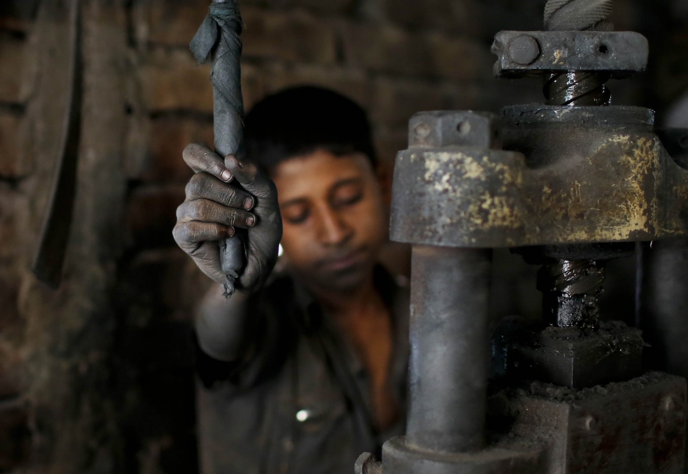 In this Sunday, June 12, 2016, photo, Abdullah, 12, works at a metal factory in Dhaka, Bangladesh. AP Photo/ A.M. Ahad
