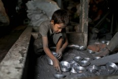 In this Sunday, June 12, 2016, photo, Ridoy, 7, works at a factory that makes metal utensils in Dhaka, Bangladesh. AP Photo/ A.M. Ahad