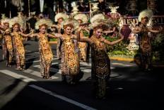 Balinese dancers perform a colossal dance at Bajra Sandhi in Denpasar. JP/Agung Parameswara