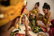 Performers prep for the street parade during the opening of the 38th Bali International Arts Festival. JP/Agung Parameswara