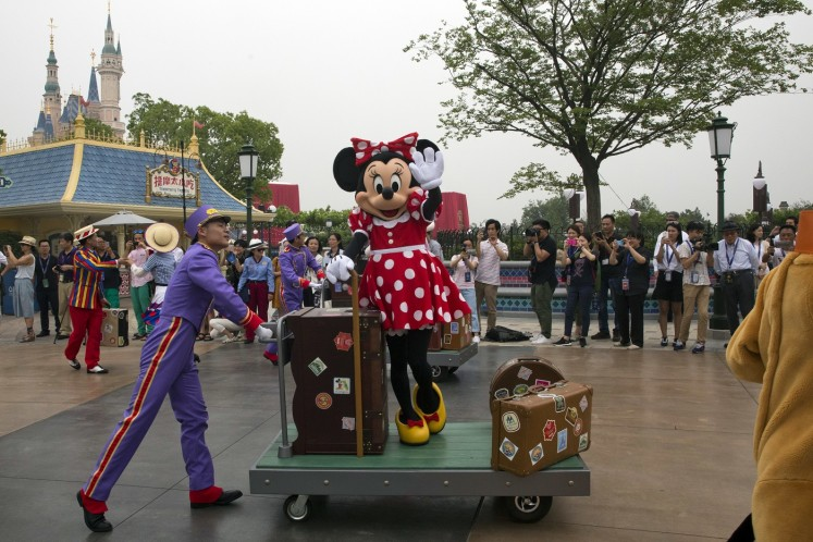 Shanghai Disneyland ride breaks down, leaving visitors suspended mid-air