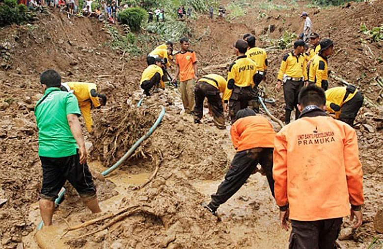 13 killed as landslides bury Central Java villages