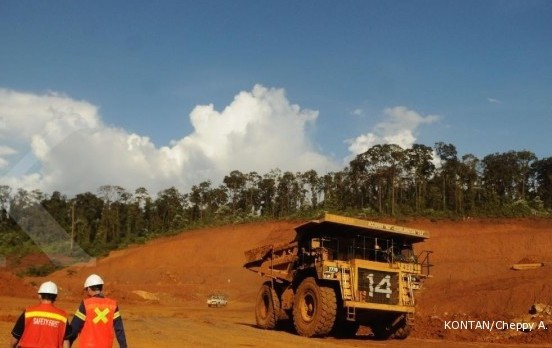 Workers monitor a mining area of nickel producer PT Vale Indonesia.