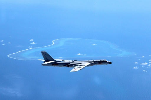 Chinese bombers make debut landing on disputed South China Sea runway