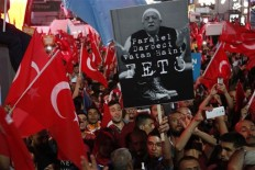 Erdogan vows to go after businesses linked to coup bid