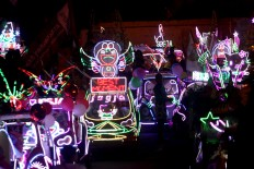 The light decorations make the pedal car carnival shine brightly at nighttime. JP/Aditya Sagita