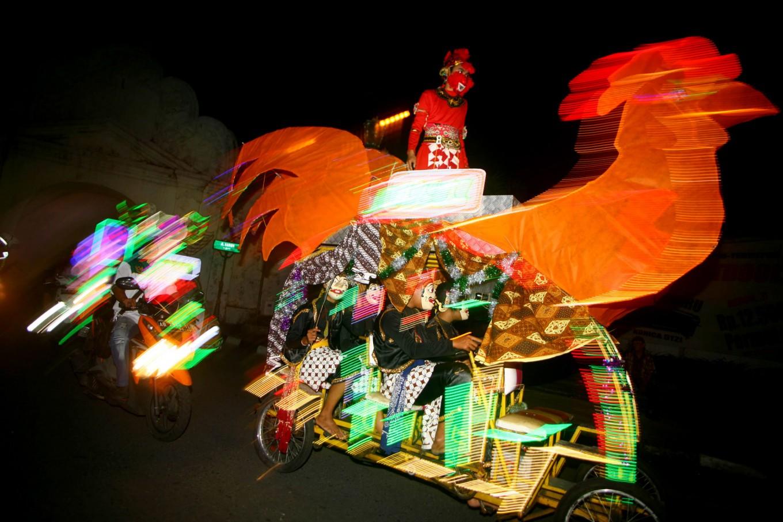 A pedal car and its passengers at the festival. JP/Aditya Sagita