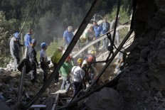 Rescuers search for survivors through rubble after an earthquake, in Accumoli, central Italy, Wednesday, Aug. 24, 2016. A devastating earthquake rocked central Italy early Wednesday, collapsing homes on top of residents as they slept. At least 23  people were reported dead in three hard-hit towns where rescue crews raced to dig survivors out of the rubble, but the toll was expected to rise as crews reached homes in more remote hamlets. AP Photo/Andrew Medichini