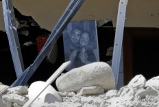 A family photo is seen among the debris of a collapsed house in Accumoli, central Italy, Wednesday, Aug. 24, 2016. The magnitude 6 quake struck at 3:36 a.m. [0136 GMT] and was felt across a broad swath of central Italy, including Rome where  residents of the capital felt a long swaying followed by aftershocks. AP Photo/Andrew Medichini