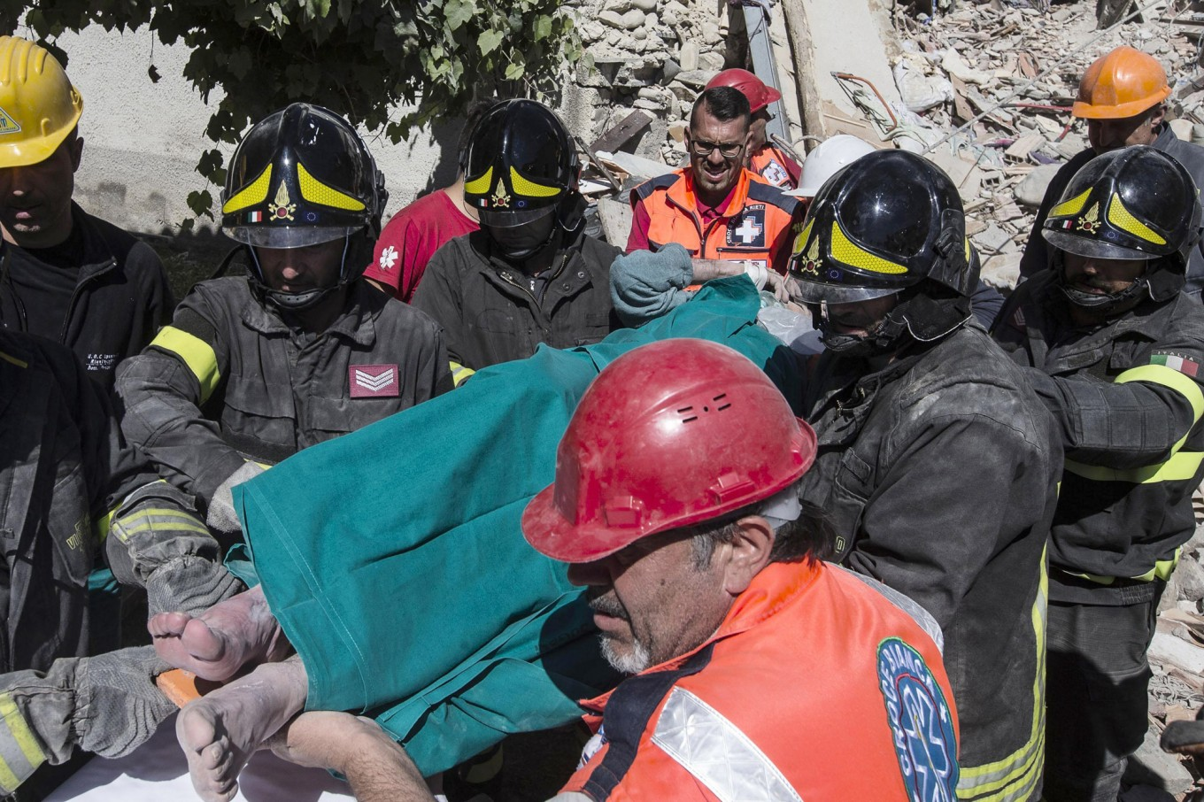 An injured man is carried on a stretcher by rescuers following an earthquake in Accumoli, central Italy, Wednesday, Aug. 24, 2016. The magnitude 6 quake struck at 3:36 a.m. [0136 GMT] and was felt across a broad swath of central Italy, including  Rome, where residents felt a long swaying followed by aftershocks. The temblor shook the Lazio region and Umbria and Le Marche on the Adriatic coast. Angelo Carconi/ANSA via AP