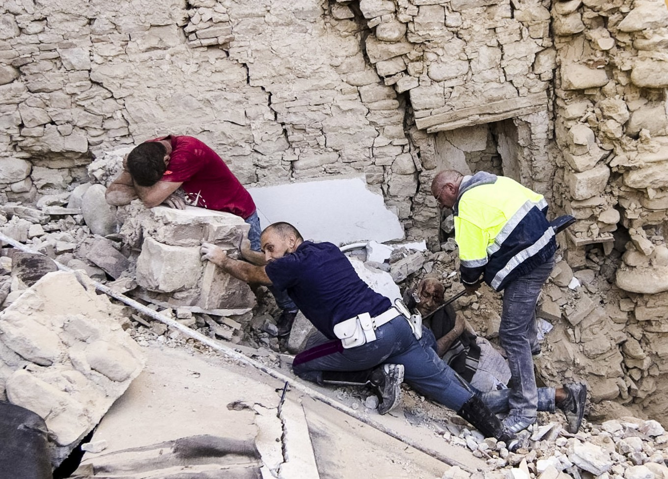 A man cries as another injured is helped in Amatrice, central Italy, where a 6.1 earthquake struck just after 3:30 a.m., Wednesday, Aug. 24, 2016. The quake was felt across a broad section of central Italy, including the capital Rome where people in homes in the historic center felt a long swaying followed by aftershocks. AP Massimo Percossi/ANSA via AP