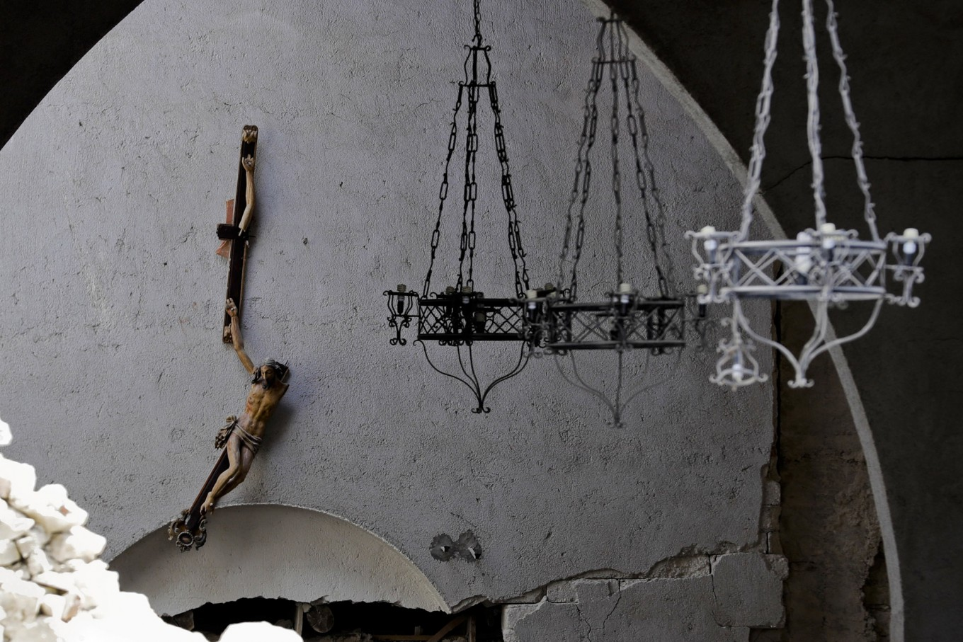 A broken crucifix hangs inside the damaged church of Santa Maria della Misericordia in Accumoli, central Italy, Wednesday, Aug. 24, 2016, after a magnitude 6 quake struck at 3:36 a.m. [0136 GMT] and was felt across a broad swath of central Italy, including Rome where residents of the capital felt a long swaying followed by aftershocks. AP Photo/Andrew Medichini