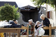 Residents sit outdoor following an earthquake in Cumuli, central Italy, Wednesday, Aug. 24, 2016. A strong earthquake in central Italy reduced three towns to rubble as people slept early Wednesday. The magnitude 6 quake struck at 3:36 a.m. [0136 GMT] and was felt across a broad swath of central Italy, including Rome, where residents felt a long swaying followed by aftershocks. The temblor shook the Lazio region and Umbria and Le Marche on the Adriatic coast. AP Photo/Andrew Medichini