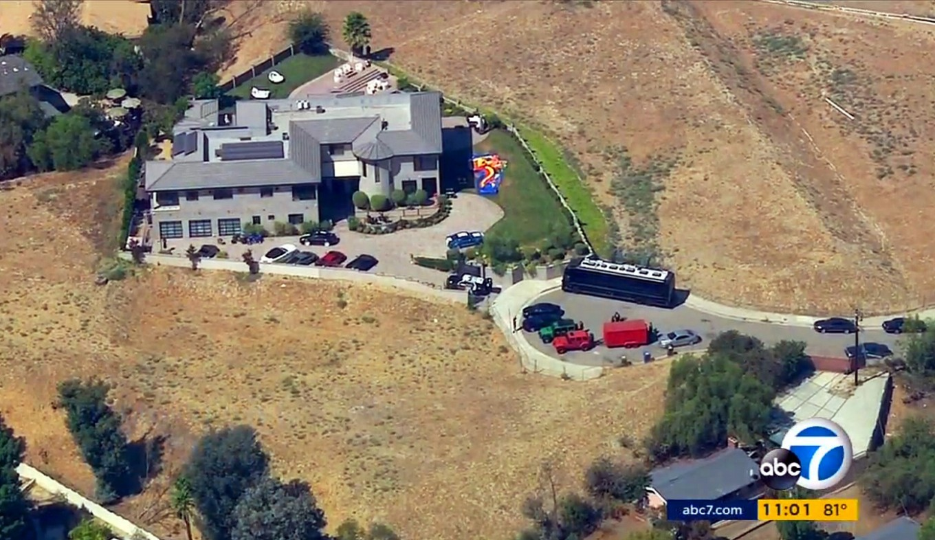 Police waiting at Chris Brown's home after woman seeks help