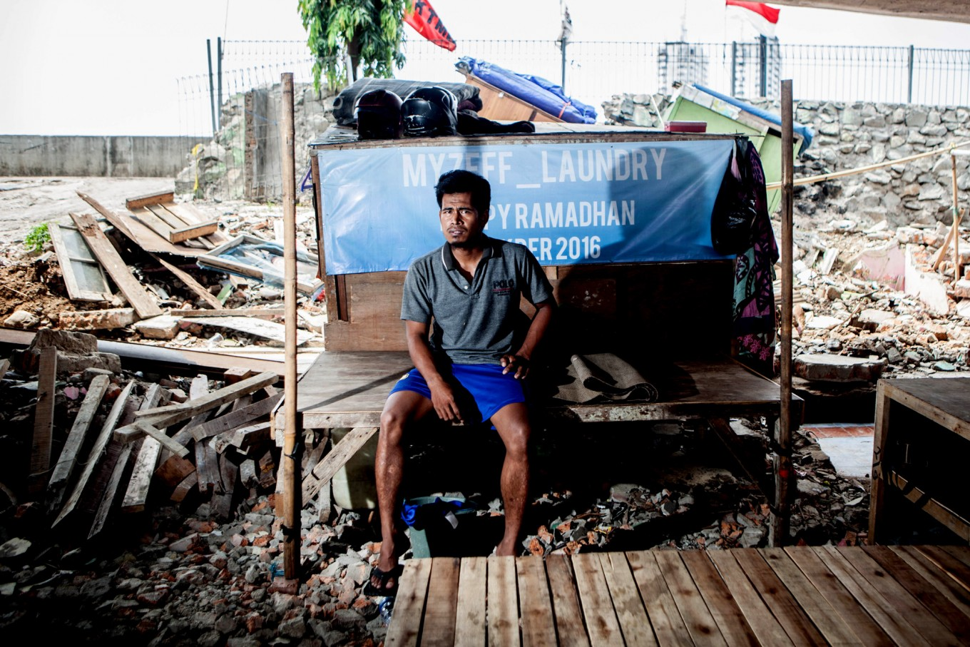Rachman, 27, lives alone in his shack, Pejagalan, Jakarta, August 2016. He has lived there since 2007. He sent her wife back to his hometown in Sumatra since the eviction. He was a parking attendant before but with the business in Kalijodo gone he now works odd jobs, if there is any. JP/Seto Wardhana