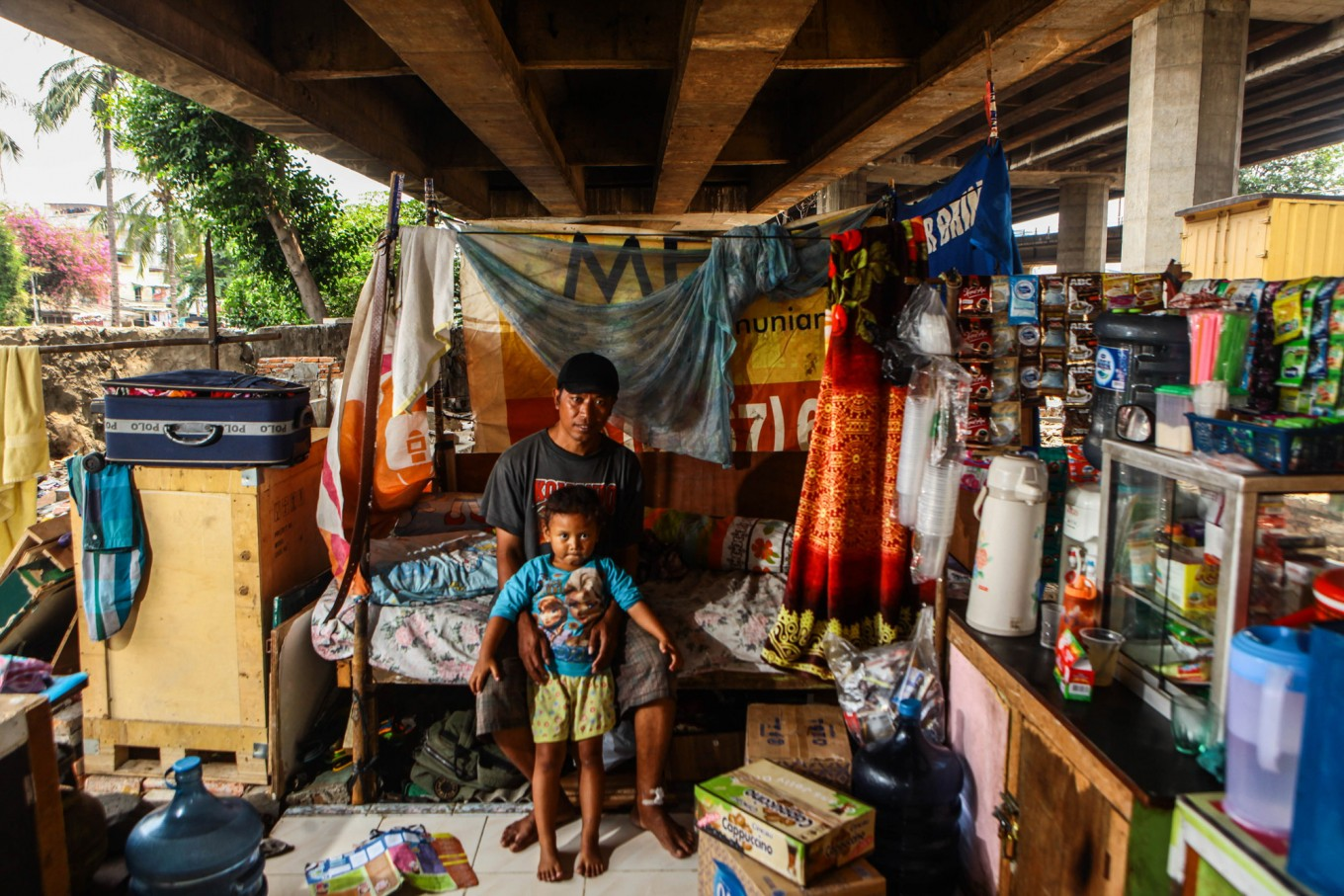 Basri, 35, lives with his daughter Hafiza, 3, and wife Sumiyati, 30, in their shack in Pejagalan, Jakarta in this photo taken August 2016. He used to be a music operator on one of the cafes in Kalijodo but he now earns his living by selling snack and coffee. Throughout his life, he has been evicted three times. JP/Seto Wardhana