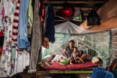 Vivianti, 35, lives with her husband and their twin sons Kevan and Kevin, 2, in the shack under the Tomang-Pluit toll road in Pejagalan. They had been living there since 2010. Before eviction, they sold meatballs but they had their meatball cart destroyed during the eviction. JP/Seto Wardhana