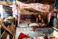 Sumiyati, 52, live with husband Aceng, 55, and granddaughter Yohana, 16, in their shack, Pejagalan, Jakarta, August 2016. She had been living there for 12 years since 2004. Her husband makes a living by becoming an ojek [motorcycle taxi] driver. JP/Seto Wardhana