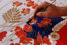 """The detail of a """"colet""""work, a painting technique in which a brush is used. JP/Ganug Nugroho Adi"""