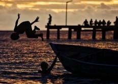 Children play at sunset at Namatota Island's dock in Kaimana, West Papua. JP/Wendra Ajistyatama