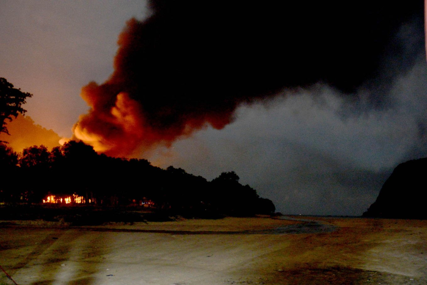 A fire burns amid a social conflict over possible gold mining on the island. JP/Tarko Sudiarno