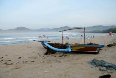 A fishing boat waits on the beach. Fishermen only sail at night in the area. JP/Tarko Sudiarno