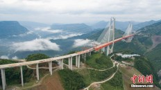 Main span of highest bridge completed in SW China