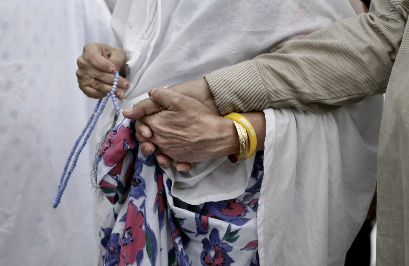 An elderly Indian woman leads her husband as they circle the Kaaba, Islam's holiest shrine, at the Grand Mosque in the Muslim holy city of Mecca, Saudi Arabia, Thursday, Sept. 8, 2016. Muslim pilgrims have begun arriving at the holiest sites in Islam ahead of the annual hajj pilgrimage in Saudi Arabia, with some weeping with their hands outstretched for a fleeting touch of the Kaaba. The cube-shaped shrine, at the center of Mecca's Grand Mosque, is the site the world's 1.6 billion Muslims pray toward five times a day. AP Photo/Nariman El-Mofty