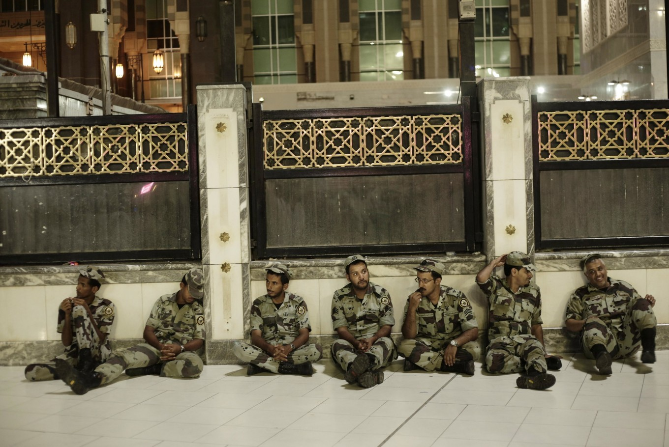 Saudi security rest before praying the Fajr, prayer before sunrise, outside the Grand Mosque in the Muslim holy city of Mecca, Saudi Arabia, Thursday, Sept. 8, 2016. Muslim pilgrims have begun arriving at the holiest sites in Islam ahead of the annual hajj pilgrimage in Saudi Arabia, with some weeping with their hands outstretched for a fleeting touch of the Kaaba. The cube-shaped shrine, at the center of Mecca's Grand Mosque, is the site the world's 1.6 billion Muslims pray toward five times a day. AP Photo/Nariman El-Mofty