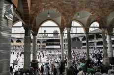 Muslim pilgrims arrive to circle the Kaaba, Islam's holiest shrine, at the Grand Mosque in the Muslim holy city of Mecca, Saudi Arabia, Thursday, Sept. 8, 2016. Muslim pilgrims have begun arriving at the holiest sites in Islam ahead of the annual hajj pilgrimage in Saudi Arabia, with some weeping with their hands outstretched for a fleeting touch of the Kaaba. The cube-shaped shrine, at the center of Mecca's Grand Mosque, is the site the world's 1.6 billion Muslims pray toward five times a day. AP Photo/Nariman El-Mofty