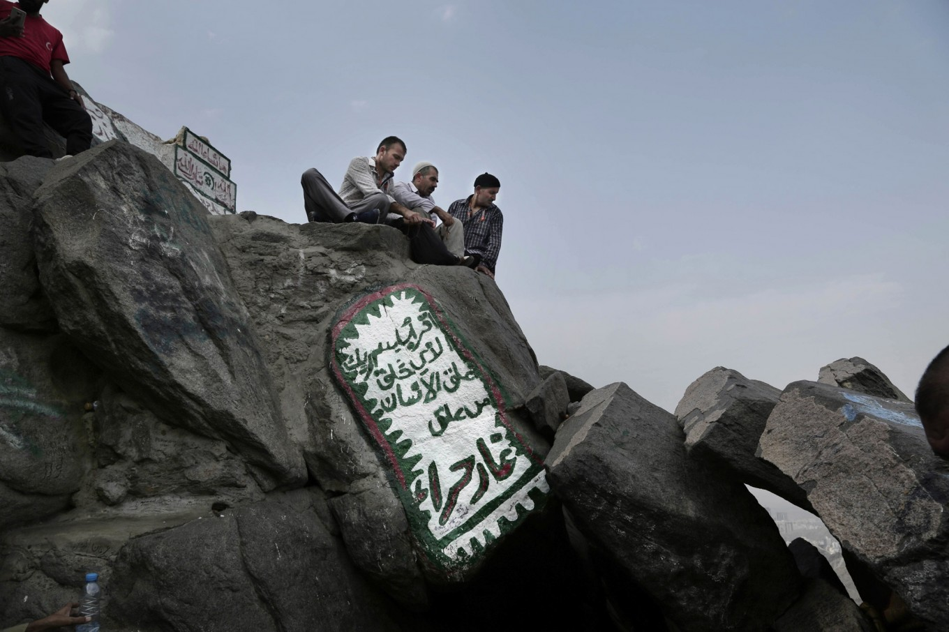 Turkish men visit Hiraa cave on Noor Mountain, where Prophet Muhammad received his first revelation from God to preach Islam, on the outskirts of Mecca, Saudi Arabia, Friday, Sept. 9, 2016. Muslim pilgrims have begun arriving at the holiest sites in Islam ahead of the annual hajj pilgrimage in Saudi Arabia. AP Photo/Nariman El-Mofty