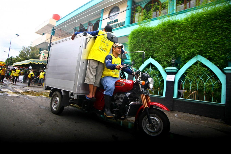 Two staffers ride a motorcycle to distribute meat to local people during Idul Adha celebrations at Jogokariyan Mosque in Yogyakarta on Sept. 12. JP/ Aditya Sagita
