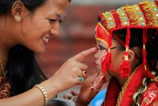 A Nepalese mother speaks with her daughter dressed as the living goddess Kumari as they wait for Kumari puja to start at Hanuman Dhoka temple, in Kathmandu, Nepal, Wednesday, Sept. 14, 2016. AP Photo/Niranjan Shrestha