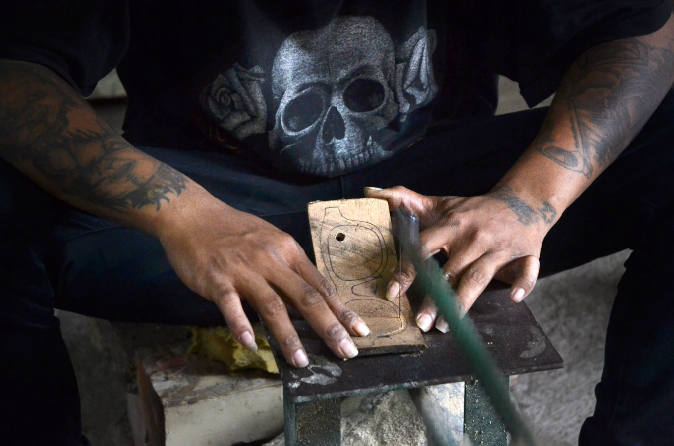 A man cuts a piece of wood following a drawn pattern in a home workshop in Malang East, Java, on Aug. 15. The frames are sold online and the buyers come from Jakarta, Surabaya and even the US and Italy. JP/Aman Rochman