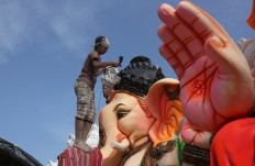 An Indian artist provides final touches to an idol of the elephant headed Hindu god Ganesha before it is carried off for worship to mark Ganesh Chaturthi festival, in Hyderabad, India, Monday, Sept. 5, 2016. The idol will be immersed in water bodies after worship at the end of the festival. AP Photo/Mahesh Kumar A.