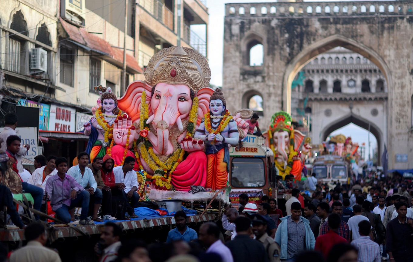 Idols of elephant-headed Hindu god Ganesha are taken on trucks in a procession before immersing them in the Hussain Sagar Lake on the final day of the festival of Ganesh Chaturthi in Hyderabad, India, Thursday, Sept. 15, 2016. The immersion marks the end of the ten-day long festival that celebrates the birth of the Hindu god. AP Photo/Mahesh Kumar A