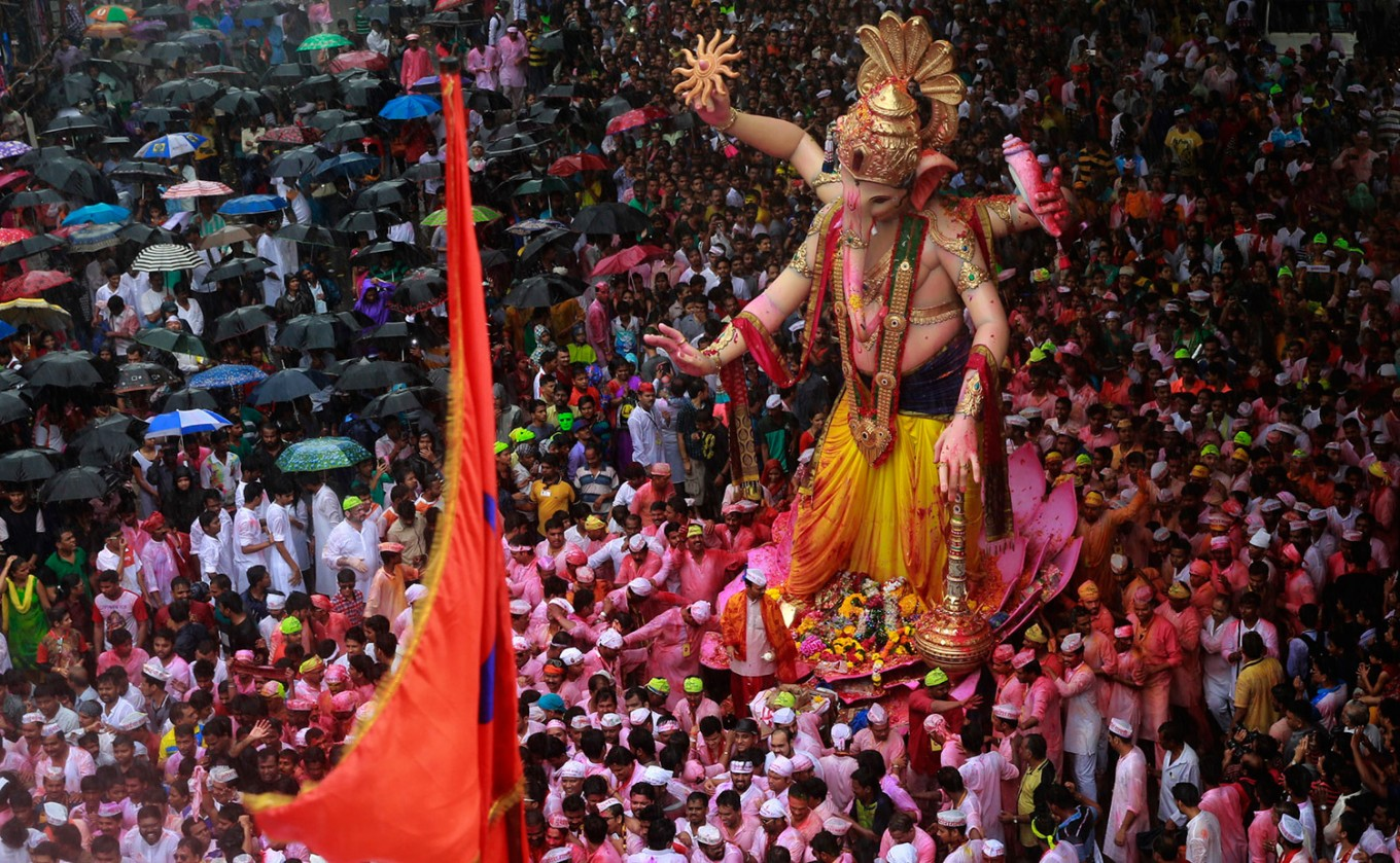 Hindu devotees participate in a procession towards the Arabian Sea where a giant idol of the elephant-headed god Ganesha will be immersed on the final day of the ten-day long Ganesha Chaturthi festival in Mumbai, India, Thursday, Sept. 15, 2016 . The last day of the 10-day celebration is the biggest day, with massive crowds singing and dancing as they carry their idols through the streets, to immerse them in the water, an act that symbolizes sending the god back to his mythical home in the snow-capped mountains taking all the worries and problems of his worshippers with him. AP Photo/Rafiq Maqbool