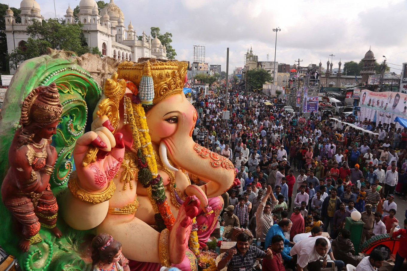 A huge idol of elephant-headed Hindu god Ganesha is taken on a truck in a procession before immersing in the Hussain Sagar Lake on the final day of the festival of Ganesh Chaturthi in Hyderabad, India, Thursday, Sept. 15, 2016. The immersion marks the end of the ten-day long festival that celebrates the birth of the Hindu god. AP Photo/Mahesh Kumar A.